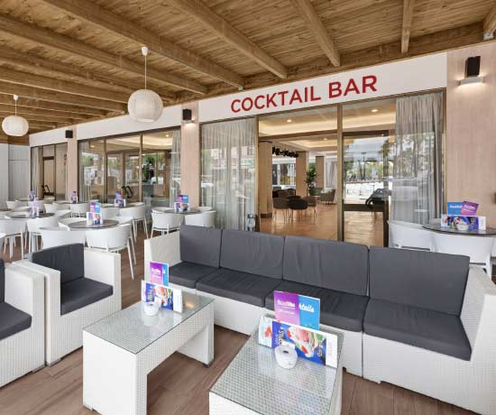 cocktails and various drinks in the bar of the hotel roc boccaccio in mallorca