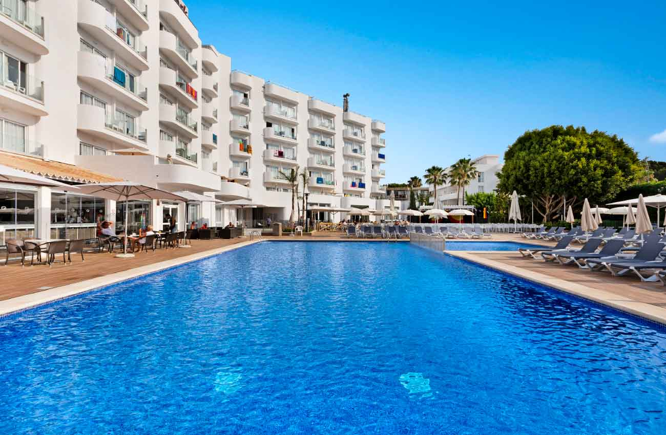summer holidays in the swimming pool of the hotel roc continental park in playa de muro