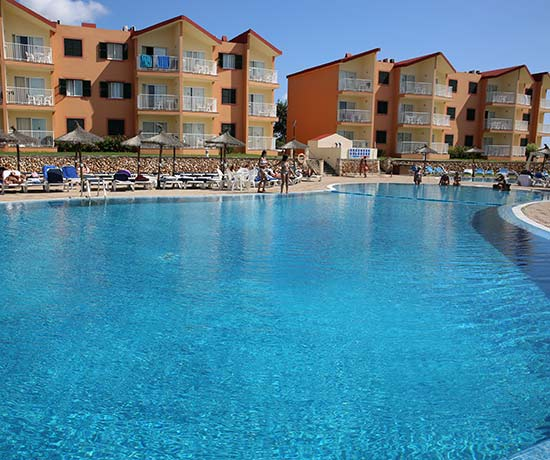 holidays in the swimming pool of the apartments roc cala blanes beach club in Ciudadela
