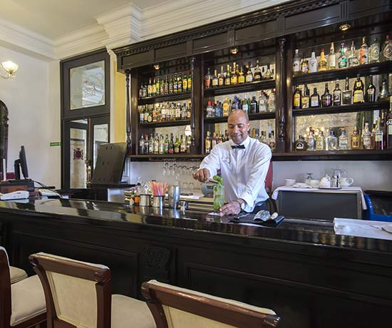 drinks with friends in the bar of the hotel roc presidente in the havana
